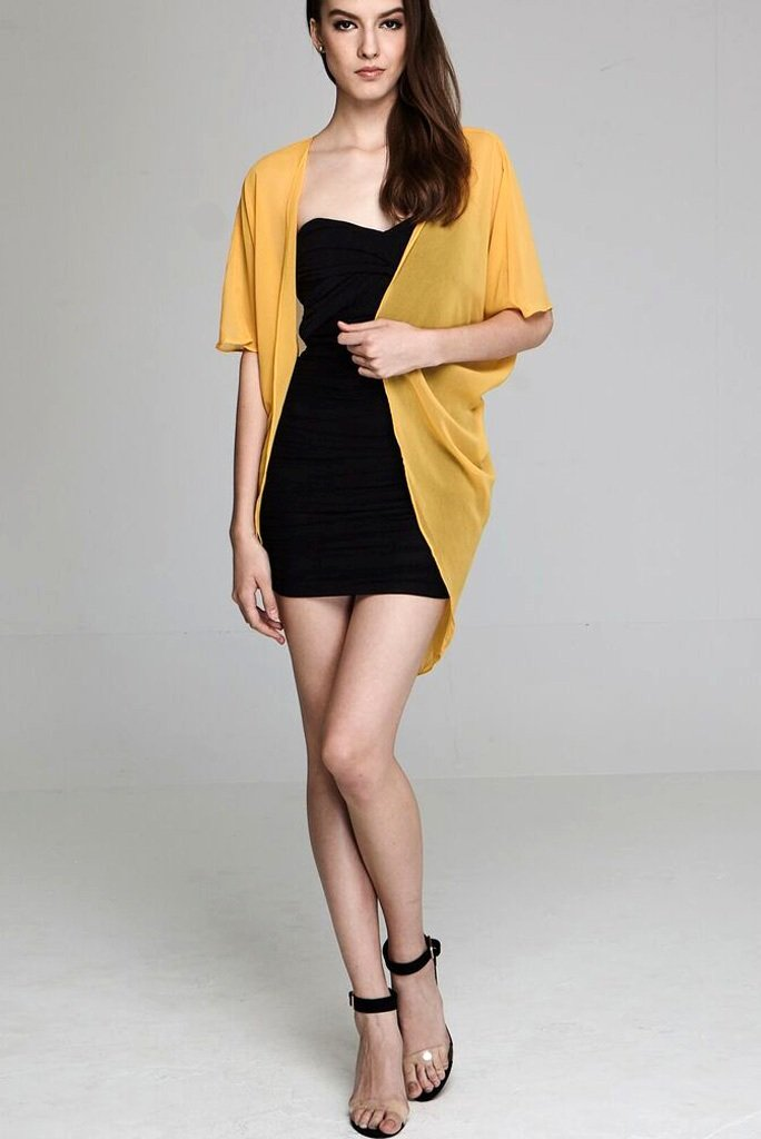 Model wearing short yellow chiffon kimono facing front