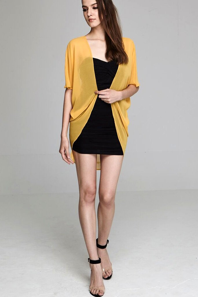 Model wearing short yellow chiffon kimono