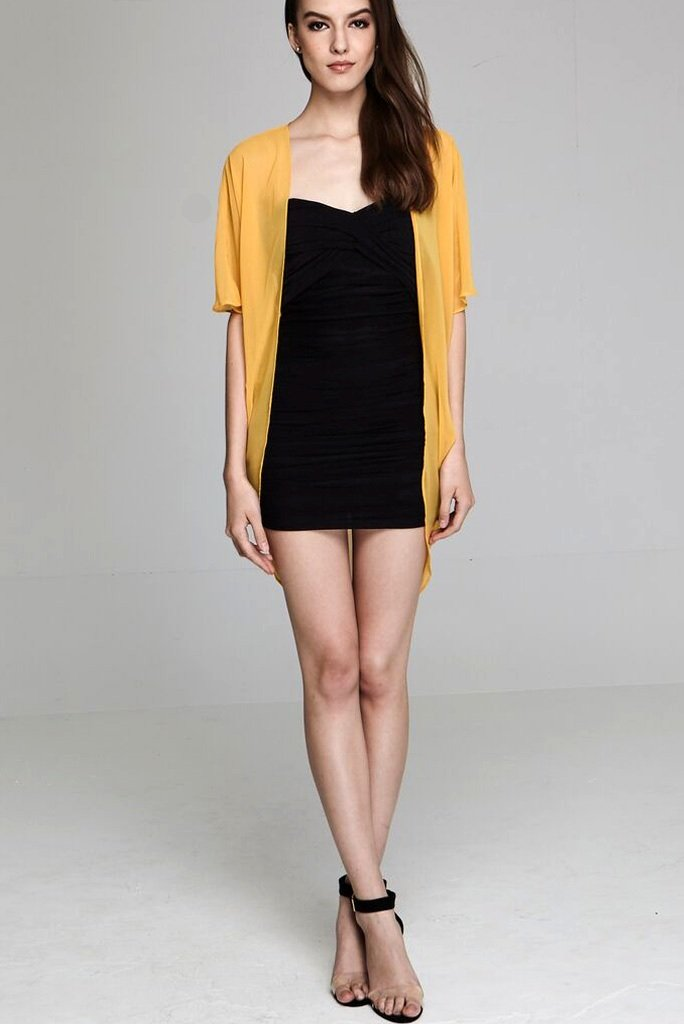 Model wearing short yellow chiffon kimono front profile