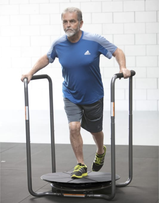Older aged man using the Core-Tex Duel Reactive Trainer to exercise