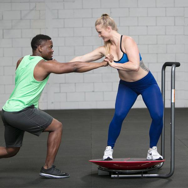 Man and women using Core-Tex Fitness Reactive Trainer to perform partner assisted exercise