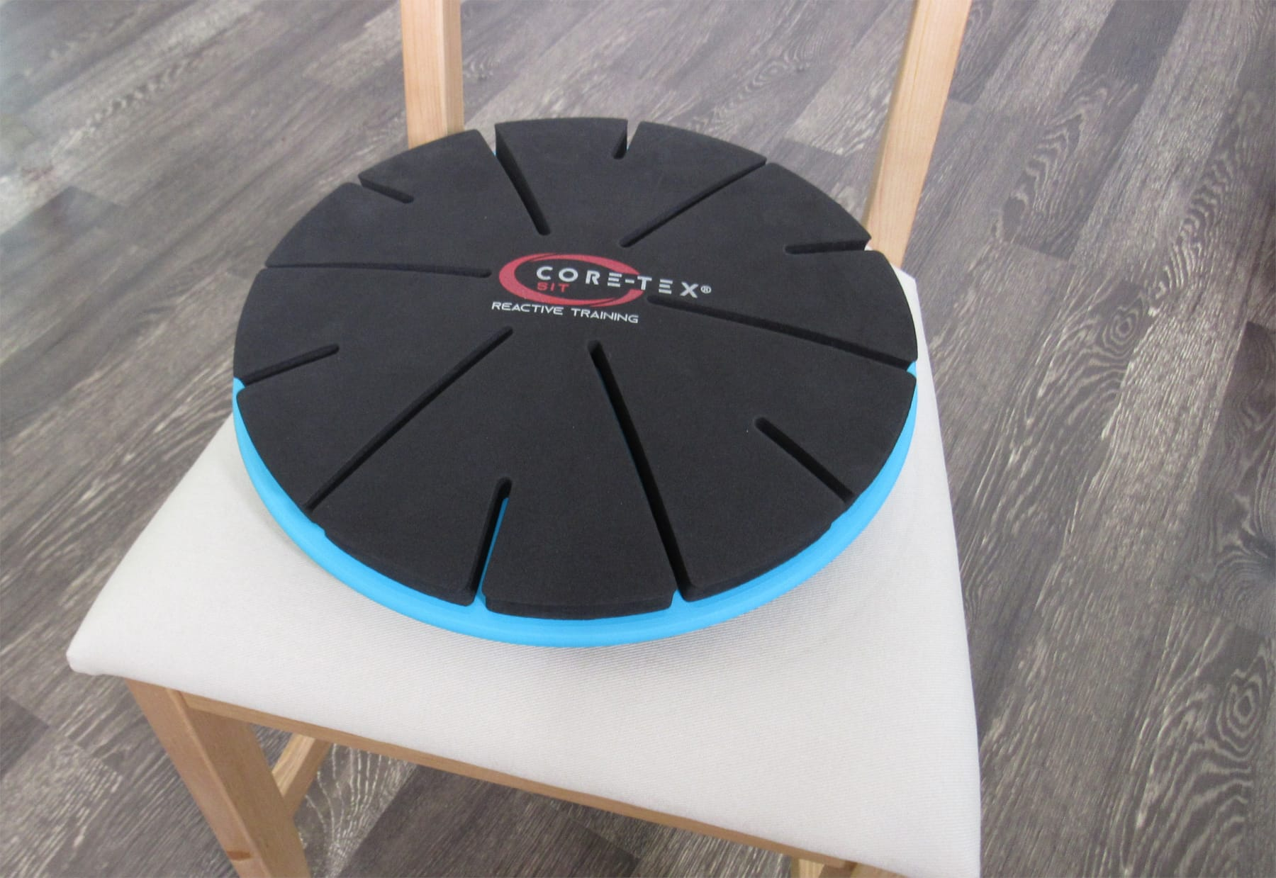 Core-Tex Sit product showcased on wooden chair with white cushion