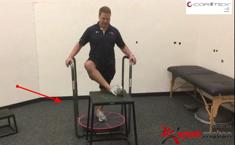 Dave Gottfield demonstrating hip mobility moves with the Core-Tex