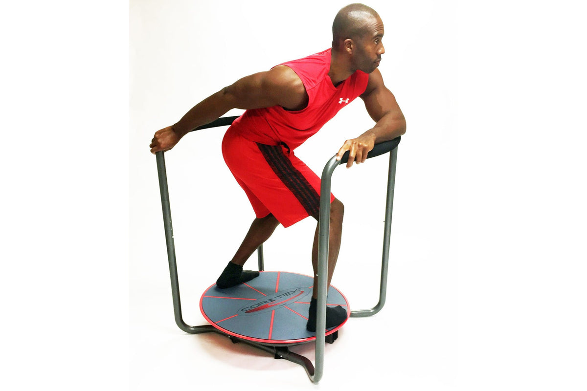 Athletic man working out using the red and black Core-Tex Reactive Trainer with duel handrails