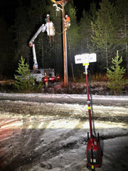 Electric Utility Lineman doing pole work while safely lit by an all-terrain LENTRY Light