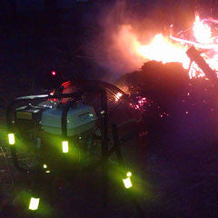 Night photo of Ventry Brush Fan accelerating the burning of a brush/debris pile