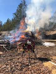 A Ventry Fan assists with burning brush piles