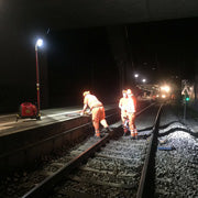 Portable LED worklight illuminates railway maintenance crew