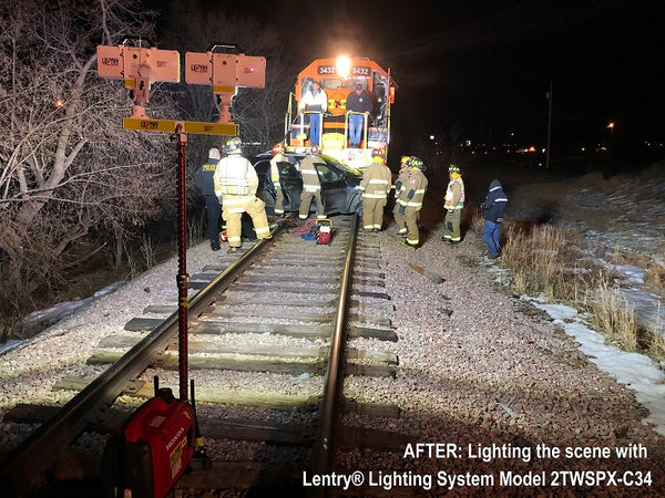 After picture of the 2-Headed Lentry Lighting system lighting the scene of a train vs. car accident