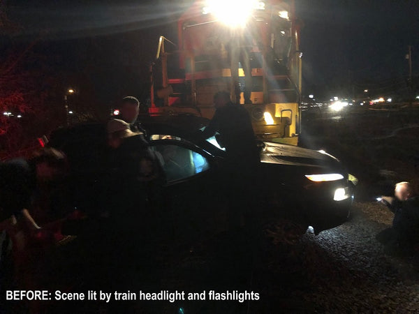 Before picture of a train vs. car accident in the dark