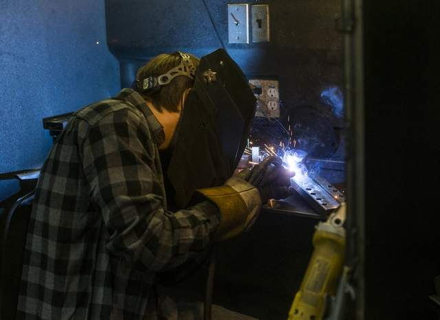 Alex welding. Photo by L. Benoit, courtesy Cd'A Press.