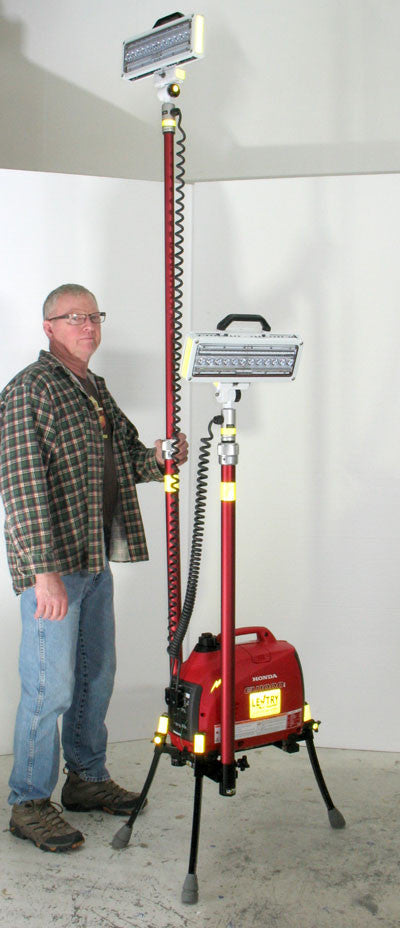 Click for an introduction. Ken stands near one Lentry emergency scene light system during a photo shoot.