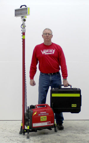 Ken stands next to tower light Lentry model 2SPECH-C. Legs and light are NOT extended and it is still over 6 feet tall. The case holds the LED head.