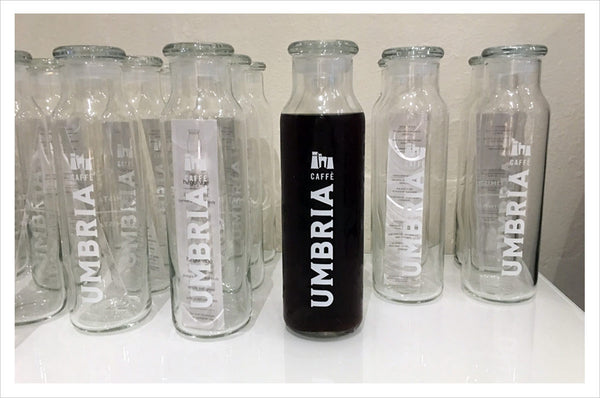 Caffe Umbria logo glass water bottle, empty or filled with cold brew coffee