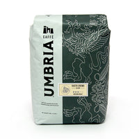 White and grey coffee bag with silver design, cream gusto cream blend medium roast label
