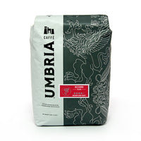 a white and grey coffee bag with silver highlights and red bizzarri blend label
