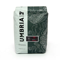 white and grey coffee bag with silver design and black and red grifo medium roast label
