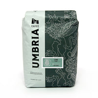white and grey coffee bag with silver design and green leone blend light roast label