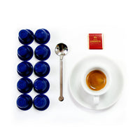 espresso in espresso cup and saucer, spoon and 10 blue nespresso capsules