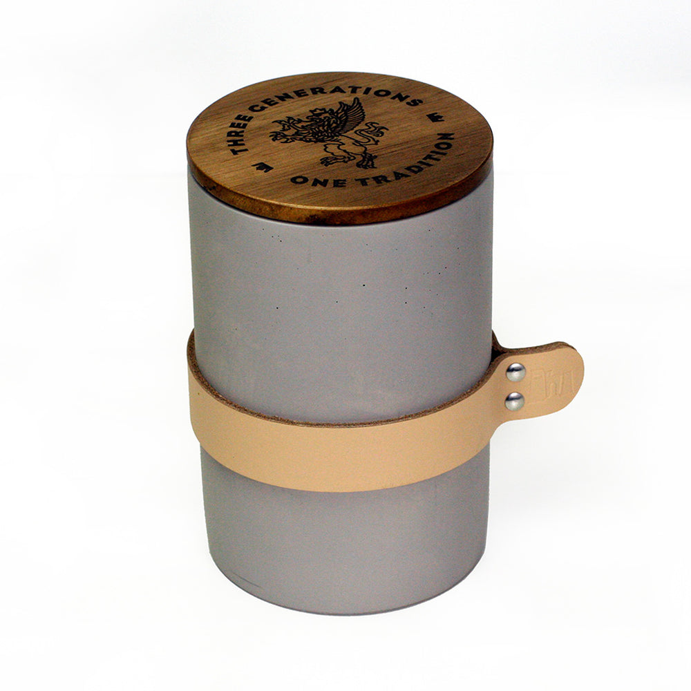 grey concrete canister with wood lid and leather tab