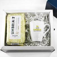 a coffee bag and coffee mug in white gift box with crinkle paper