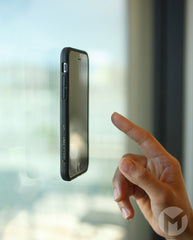 Anti-Gravity Case for iPhone 5 Stuck to Glass