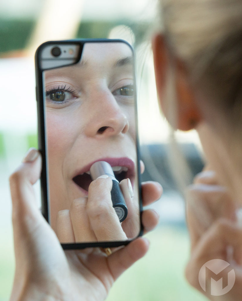 Woman Applying Makeup using Mirror iPhone Case