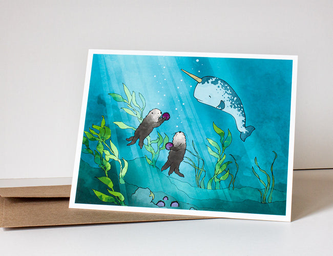 Narwhal & Sea Otter Greeting Card - Sharing Urchins