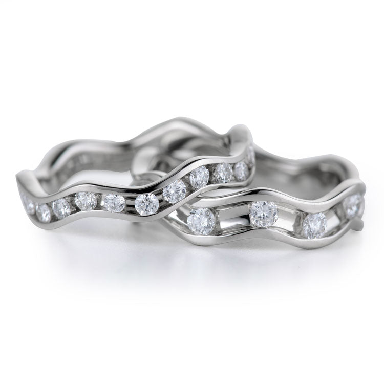 round diamonds flowing in an 18k white gold channel in Davidson Jewels designed bands