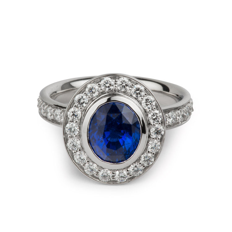 custom designed engagement ring by Davidson Jewels unheated oval deep blue sapphire accented with a halo of round diamonds