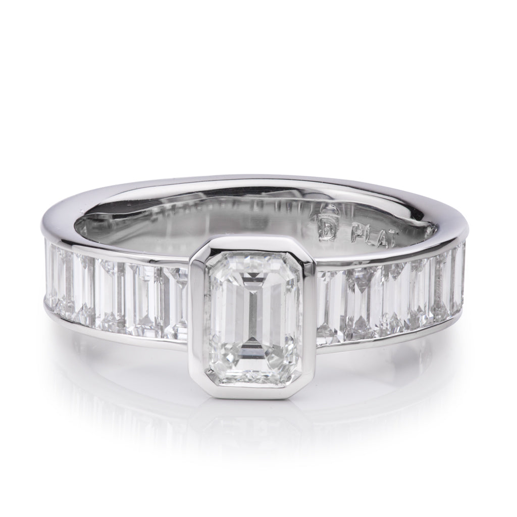 modern minamalist engagement ring with emerald cut diamond accented with baguettes on each side created by Davidson Jewels