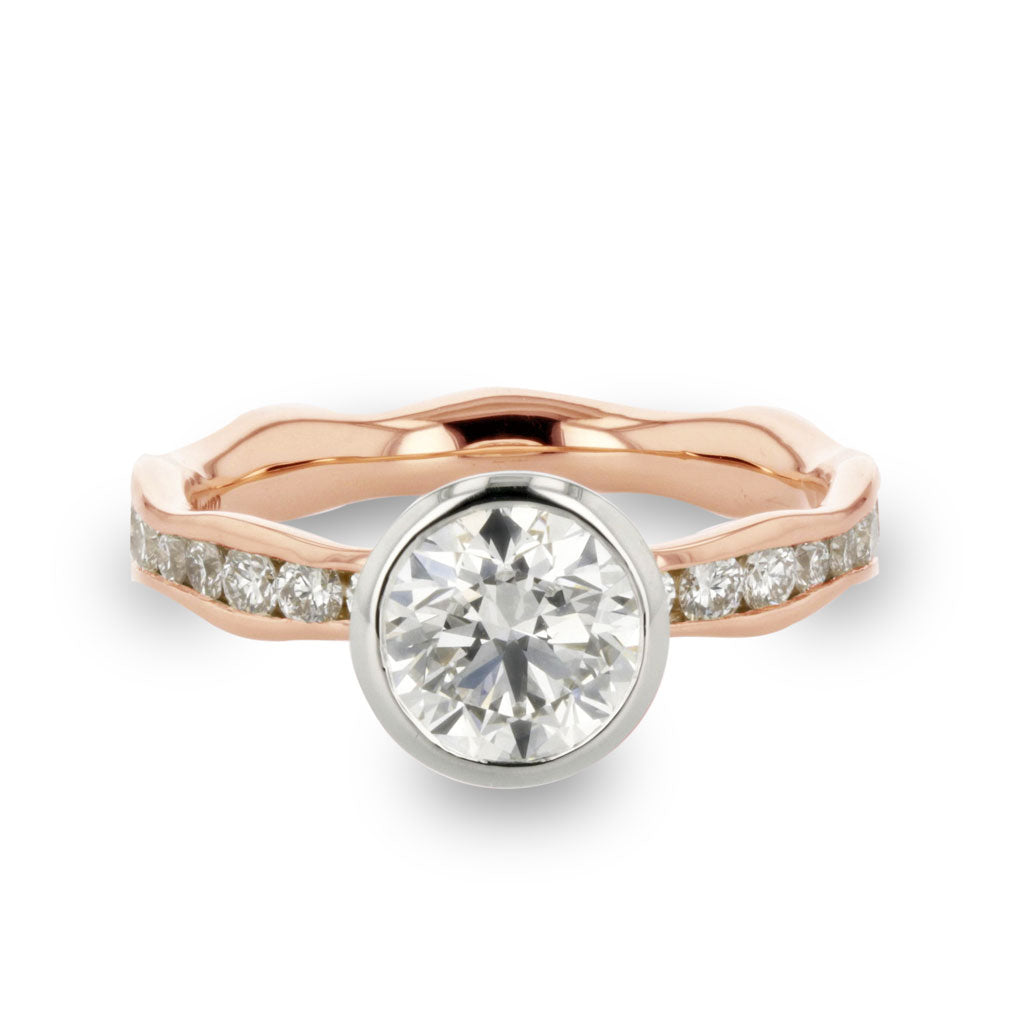 diamond engagement ring made and designed by Davidson Jewels in 18k rose gold and platininum