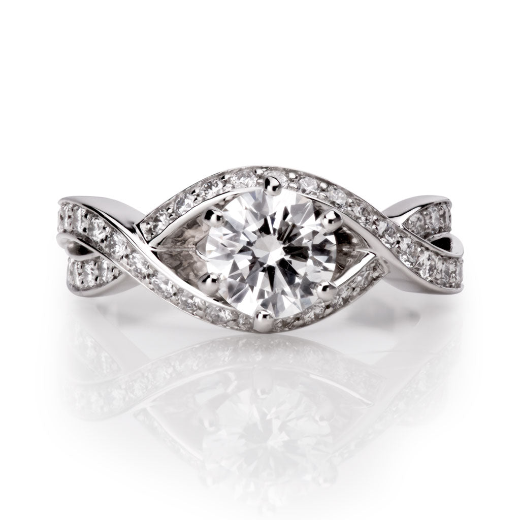 Custom designed round brilliant cut diamond and platinum engagement ring designed by Davidson Jewels Calgary