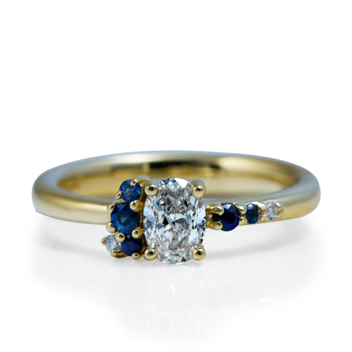 custom designed Davidson Jewels diamond and sapphire engagement ring