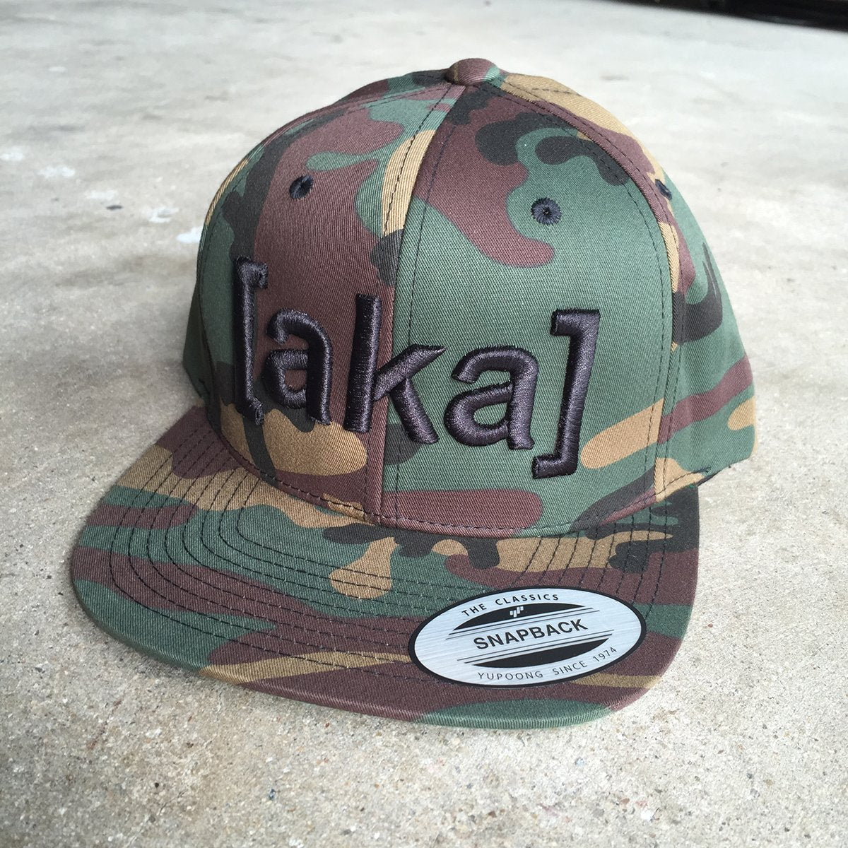 AKA Snapback Hat - Black on Camo - [aka]