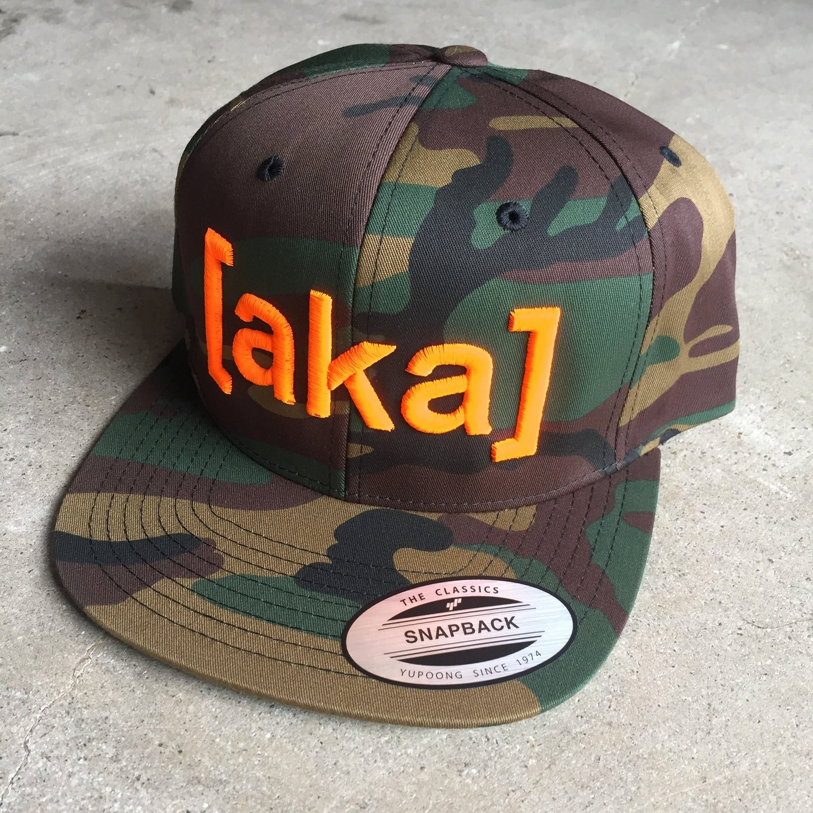AKA Snapback Hat - Safety Orange on Camo - [aka]