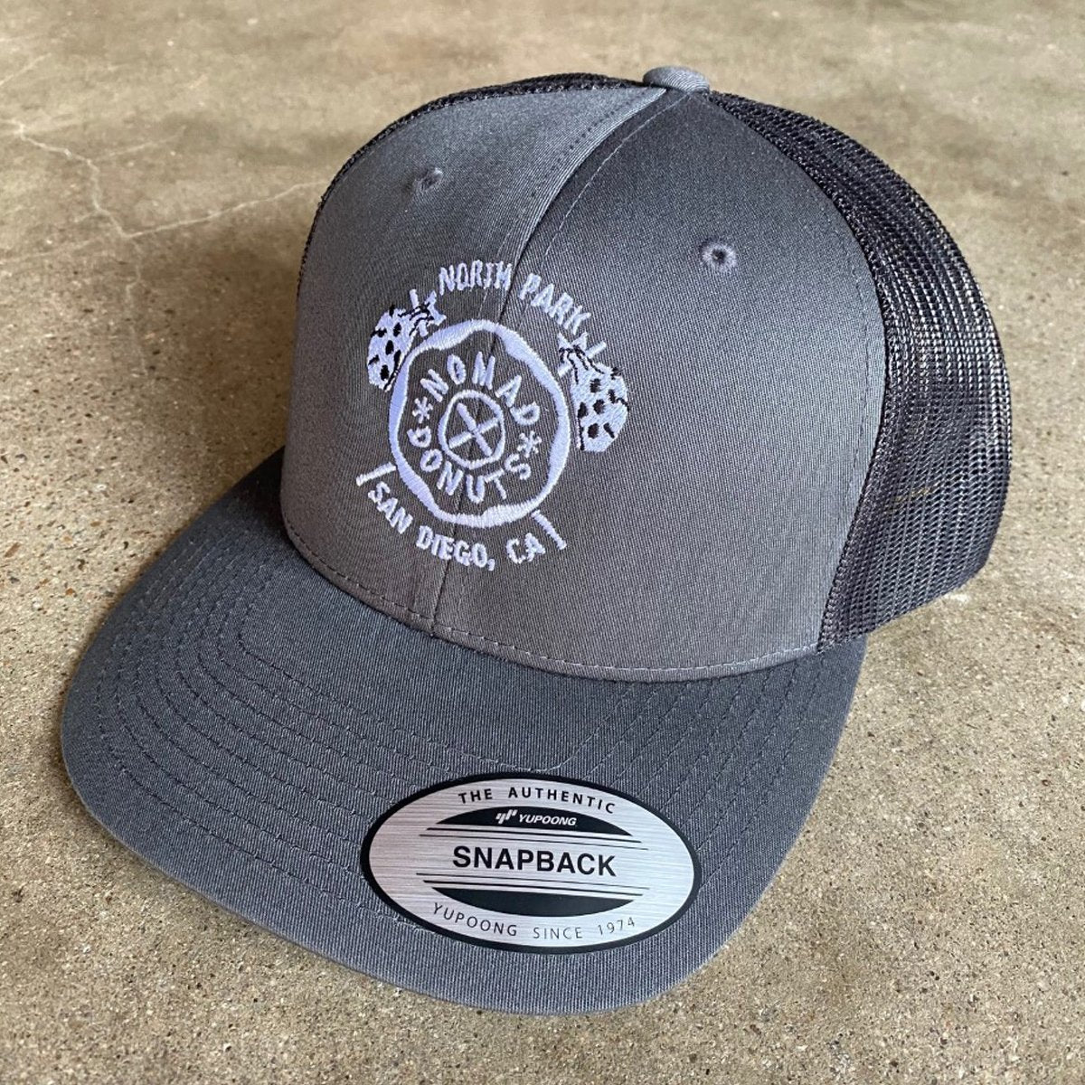 Embroidered Nomad Donuts Snapback Hat - CHARCOAL - [aka]