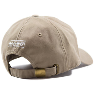 6-panel unconstructed Cotton tan beige dad hat featuring BLED letter logo felt patch on the front and BLED logo embroidered on the back with adjustable strap closure. skate, skateboarding, hype, streetwear
