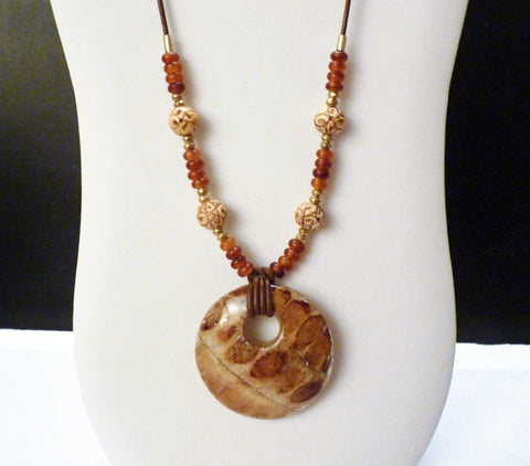 Wood Pendant, Carved Bone Beads and Brass African Beads on Brown Leather Necklace
