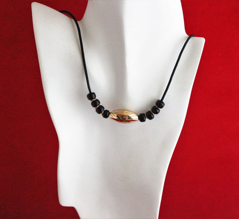 Large Bronze Etched Melon Bead with Black Beads on Black Leather Cord