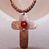Textured Copper Cross Necklace with Carnelian Cabochon and Copper Beads on Brick Red Leather Cord