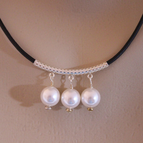 Three White Swarovski Crystal Pearls on Sterling Tube and Black Leather Cord