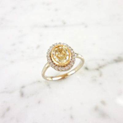 Oval Light Yellow Diamond Halo Bezel Engagement Ring
