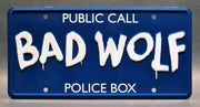 Replica metal stamped police box license plate garage decor from Doctor Who with Wilfred Mott