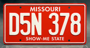 Replica metal stamped Missouri license plate garage decor from Planes, Trains and Automobiles starring Kevin Bacon