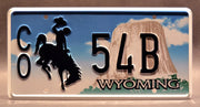 Replica metal stamped Wyoming license plate garage decor from Longmire with Sheriff Walt Longmire