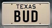 Replica metal stamped Texas license plate garage decor from Urban Cowboy starring Bob Seger