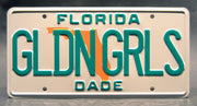 Replica metal stamped Florida license plate garage decor from The Golden Girls with Sophia and Blanche