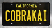 Replica metal stamped license plate garage decor from Cobra Kai starring Peyton List