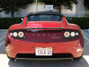 TSLA 10 license plate on Elon Musk's Tesla Roadster